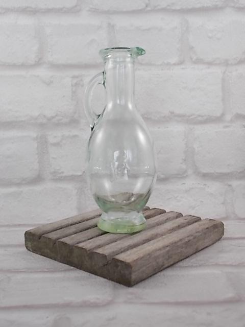 """Aiguière de Vinaigre de Vin Rouge, offert par la marque """"Lesieur"""". En verre moulé teinté Vert d'eau, contenance 20 Cl."""